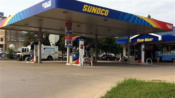 FILE- In this Thursday, Aug. 16, 2012, file photo, gas prices are advertised at a Sunoco gas station and market in Lapeer, Mich. U.S. drivers are paying an average of $3.72 per gallon on Monday, Aug. 20, 2012. That's the highest price ever on this date, according to auto club AAA, a shade above the $3.717 average on Aug. 20, 2008. A year ago, the average was $3.578. (AP Photo/Mike Householder)