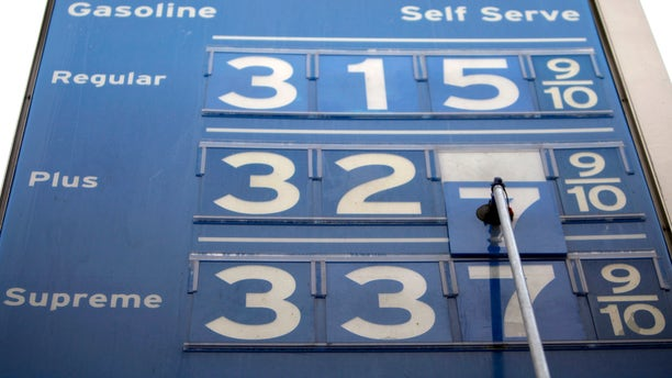 Prices are reduced two-cents on the gallon at a Chevron gas station in Los Angeles on Tuesday, Nov. 23, 2010. (AP)
