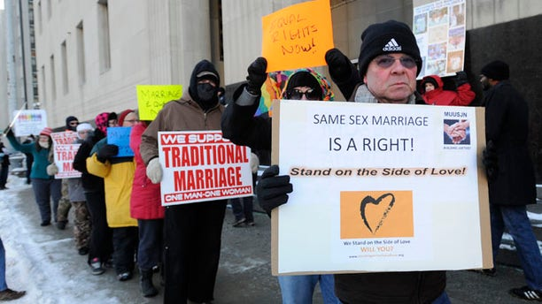 Mar. 3, 2014: Protestors demonstrate outside Federal Courthouse before a trial that could overturn Michigan's ban on gay marriage in Detroit.