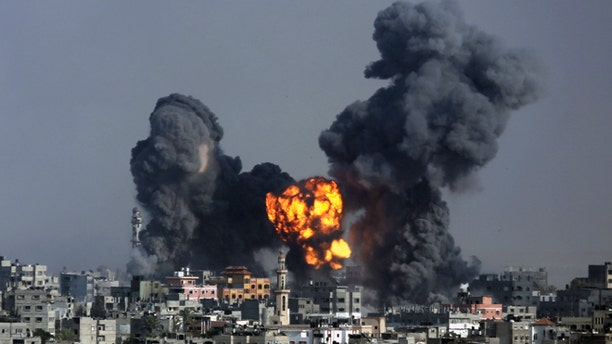July 22, 2014: Smoke and fire from the explosion of an Israeli strike rise over Gaza City.
