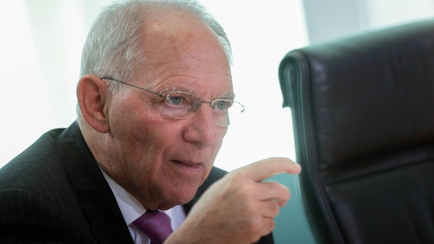 German Finance Minister Wolfgang Schaeuble attends the weekly cabinet meeting of the German government at the chancellery in Berlin, Wednesday, March 15, 2017. (AP Photo/Markus Schreiber)