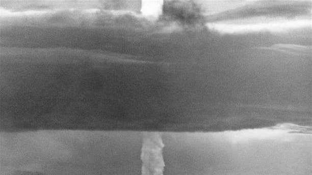 In this May 21, 1956 photo, the stem of a hydrogen bomb moves upward through a heavy cloud after the bomb was detonated over Namu Island in the Bikini Atoll, Marshall Islands.