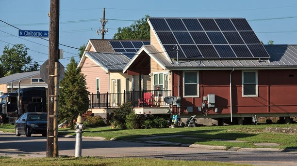 A 2015 photo shows houses built by Make It Right, equipped with solar panels.