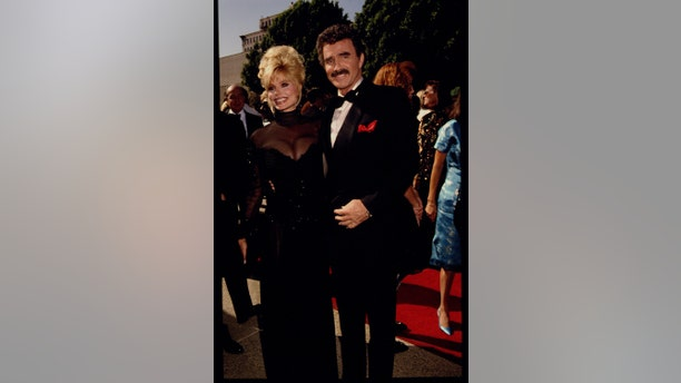 Loni Anderson and Burt Reynolds attend the 44th Emmy Awards in 1992.