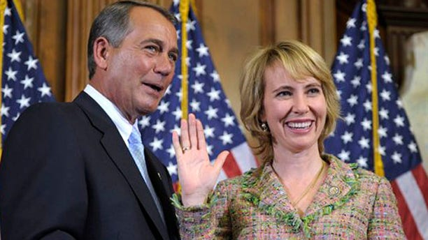 FILE - In this Jan. 5, 2011 file photo, House Speaker John Boehner reenacts the swearing in of Rep. Gabrielle Giffords, D-Ariz., on Capitol Hill in Washington. Congressional officials say Giffords has been shot in her district. (AP Photo/Susan Walsh, File)