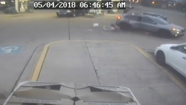 A young girl jumps out of a moving SUV during a carjacking at a Chicago-area gas station on Friday.