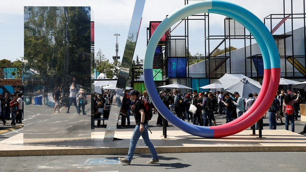 An attendee walks past a sculpture during the Google I/O 2016 developers conference in Mountain View, California May 19, 2016. (REUTERS/Stephen Lam)