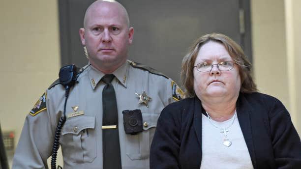 March 20, 2015: Joyce Hardin Garrard walks to the Etowah County Judicial Building from the Etowah County Detention Center in Gadsden, Ala.
