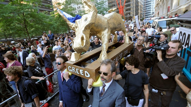 Oct. 9: A coalition of clergy carry a 'False Idol' to the Occupy Wall Street encampment in Zuccotti Park in New York.