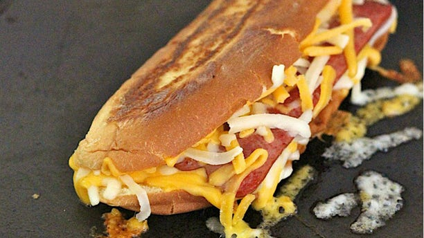 The cheesy take on a classic hot dog is too tasty to miss.
