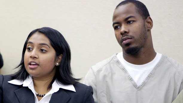 Oct. 20: Dominic L. Holt-Reid, right, listens as his attorney Priya Tamilarasan talks to the judge during his arraignment hearing in Franklin County Common Pleas Court in Columbus, Ohio. Reid accused of pointing a handgun at his pregnant girlfriend and forcing her to drive to an abortion clinic has been charged with attempted murder under an Ohio law prohibiting the unlawful termination of a pregnancy, a prosecutor said Wednesday. (AP)