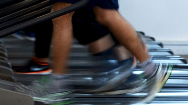 Apr 13, 2015: Men jog on treadmills inside a gym. (Reuters)