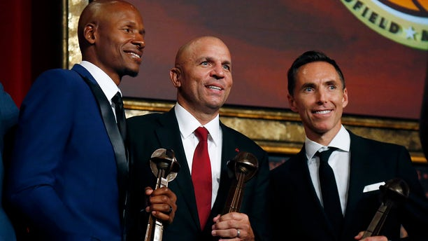 Retired NBA players Ray Allen, Jason Kidd and Steve Nash, from left, pose for a photo after induction ceremonies at the Basketball Hall of Fame, in Springfield, Mass., Sept. 7, 2018.