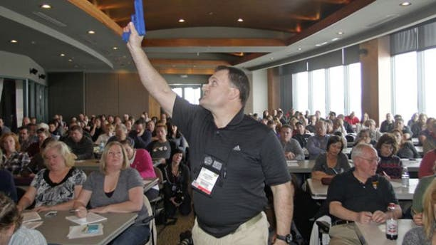 Dec. 27, 2012: Clark Aposhian, President of Utah Shooting Sport Council, demonstrates with a plastic gun during concealed-weapons training for 200 Utah teachers.