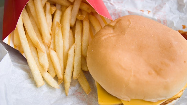 Fast food wrappers contains chemicals that have recently been linked to slowing down metabolism.