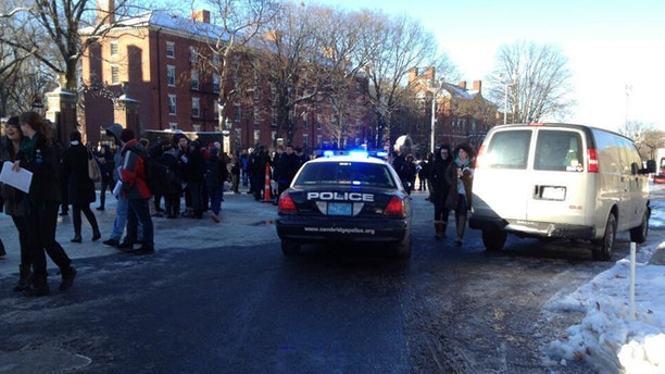Dec. 16, 2013: Students are seen at Harvard University after being evacuated over unconfirmed reports of explosives.