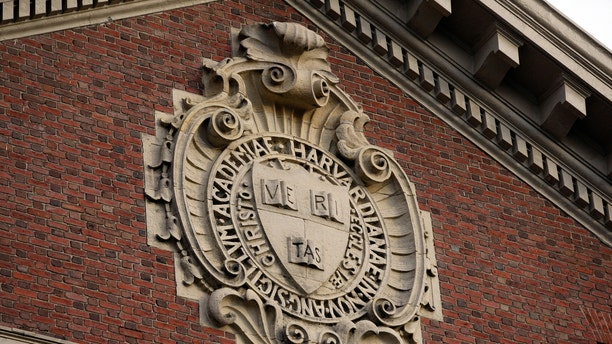 A seal hangs over a building at Harvard University in Cambridge, Massachusetts November 16, 2012. REUTERS/Jessica Rinaldi (UNITED STATES - Tags: EDUCATION) - RTR3AIAS
