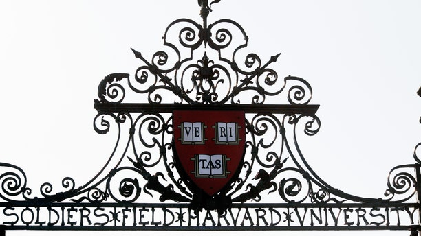 Harvard's seal sits atop a gate to the athletic fields at Harvard University in Cambridge, Massachusetts Sept. 21, 2009. (REUTERS/Brian Snyder)