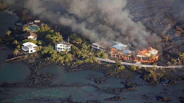 Lava destroys homes in the Kapoho area, east of Pahoa, during ongoing eruptions of the Kilauea Volcano in Hawaii, U.S.