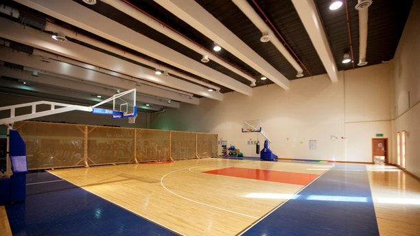 An indoor basketball court stands empty inside the compound of the U.S. embassy in Baghdad December 14, 2011. The compound, located in Baghdad's Green Zone, will be the home for thousands of American citizens left after the U.S. military completes its withdrawal this month. REUTERS/Lucas Jackson (IRAQ - Tags: POLITICS CONFLICT MILITARY SOCIETY) - RTR2V843