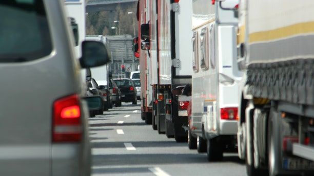 Traffic jam caused by a fatal accident on the highway during rush hour.