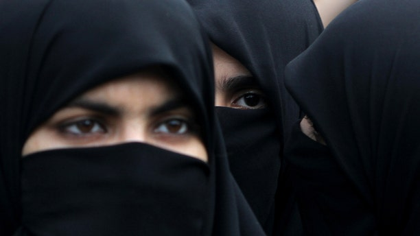 Supporters of Pakistani religious party Jamaat-e-Islami hold a rally to observe the World Hijab (veil) Day in Islamabad, Pakistan, Wednesday, Sept. 4, 2013. Scores of the party's female supporters wearing veils gathered to advocate the necessity of veil for the Muslim women. (AP Photo/B.K. Bangash)