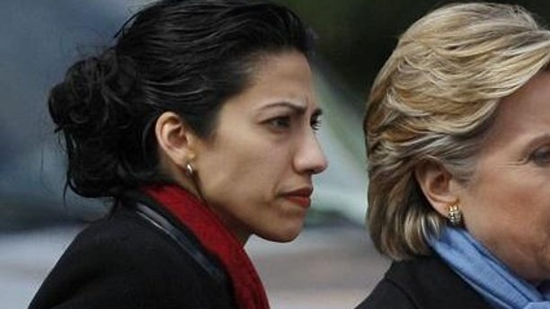 Hillary Clinton and Huma Abedin (Reuters photo)