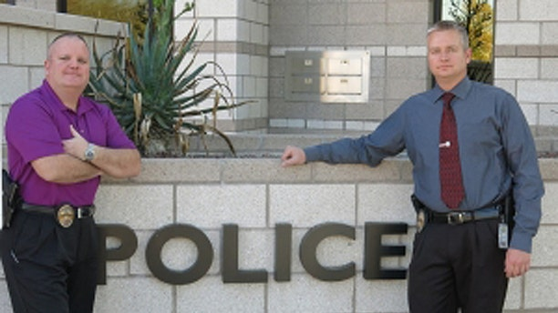 Peoria, Ariz., homicide detectives Chris Boughey, (l.), and Jeff Balson, (r.), have made it their mission to educate other law-enforcement officers about honor violence. (Courtesy: Chris Boughey)