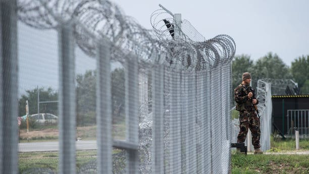 A Hungarian soldier patrols at the transit zone at Hungary's southern border with Serbia.