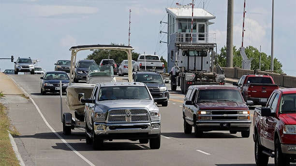 People drive over a drawbridge in Wrightsville Beach, N.C., as they evacuate the area in advance of Hurricane Florence on Tuesday.