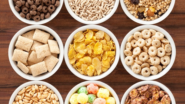 Top view of 9 bowls containing varieties of breakfast cereals