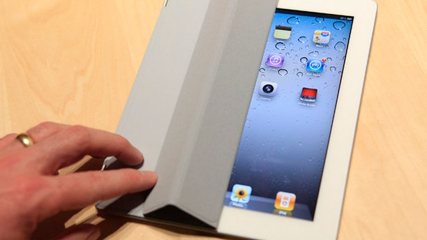 March 2: The iPad 2 with a Smart Cover is shown in use in the demonstration area after the iPad 2 launch during an Apple event in San Francisco, Calif.