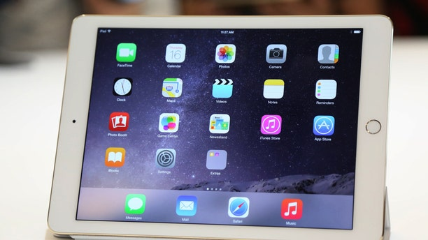 A new iPad is seen follownig a presentation at Apple headquarters in Cupertino, California Oct.16, 2014.