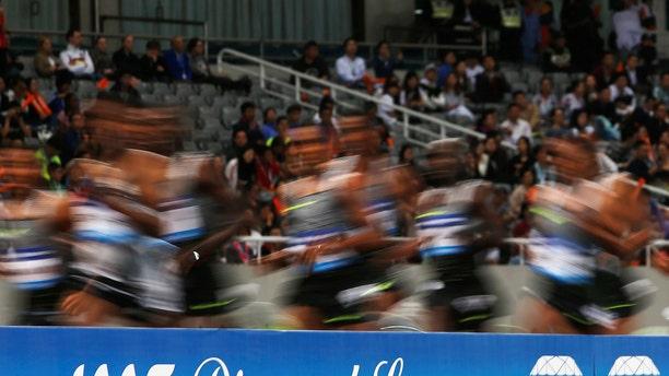 File photo - Athletes run past a Diamond League board during an IAAF Athletics Diamond League meeting in Shanghai Stadium, Shanghai, China on May 14 2016 (REUTERS/Aly Song).