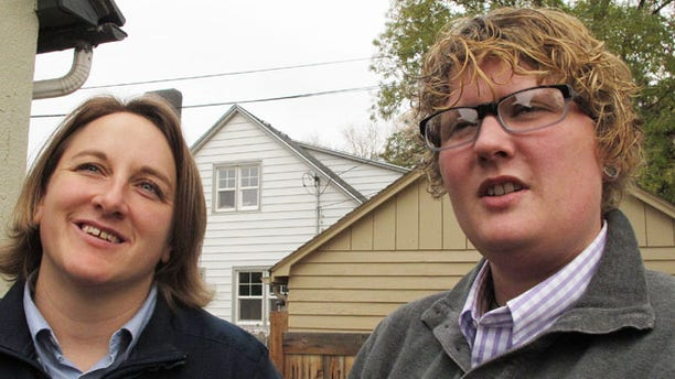 Nov. 8, 2013: Amber Beierle, left, and Rachael Robertson talk about their role as plaintiffs in a federal lawsuit at their home in Boise, Idaho.