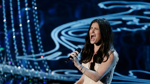 """March 2, 2014. Idina Menzel performs nominated original song """"Let it Go"""" by Robert Lopez and Kristen Anderson-Lopez, for the film """"Frozen"""" at the 86th Academy Awards in Hollywood, California."""