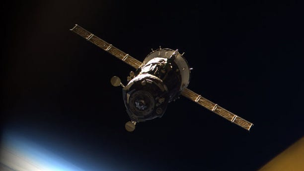 The Russian Soyuz TMA-16 spacecraft carrying astronaut Jeff Williams and cosmonaut Maxim Suraev is seen undocking from the International Space Station on March 18, 2010 in this photo taken from inside the station by Japanese astronaut Soichi Noguchi.