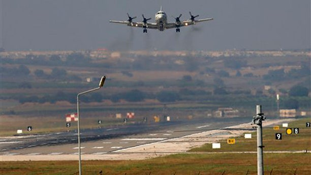 A United States Navy plane approaches to land at the Incirlik Air Base, in Adana, in the outskirts of the city of Adana, southeastern Turkey, Tuesday, July 28, 2015.