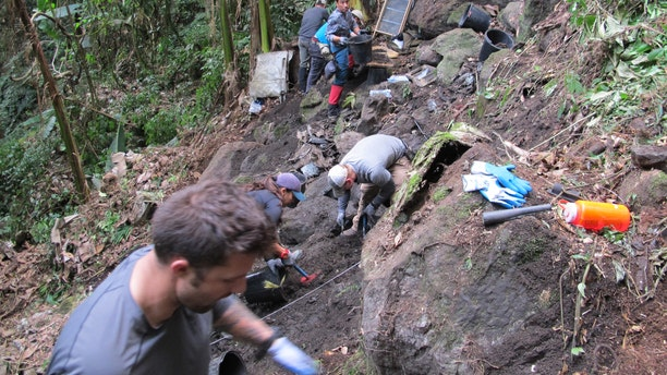 Members from Defense POW/MIA Accounting Agency (DPAA), remove soil from a test unit as part of a DPAA investigation mission near Bhismaknagar Village, Arunachal Pradesh, India, Dec. 01, 2016. (DoD photo by U.S. Marine Staff Sgt. Christopher Cantu)
