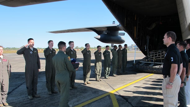 Members from Defense POW/MIA Accounting Agency (DPAA), conduct a dignified transfer ceremeony for possible human remains during a DPAA investigation mission at the Diburgarh Airport, Arunachal Pradesh, India, Dec. 13, 2016. (DoD photo by U.S. Marine Staff Sgt. Christopher Cantu)