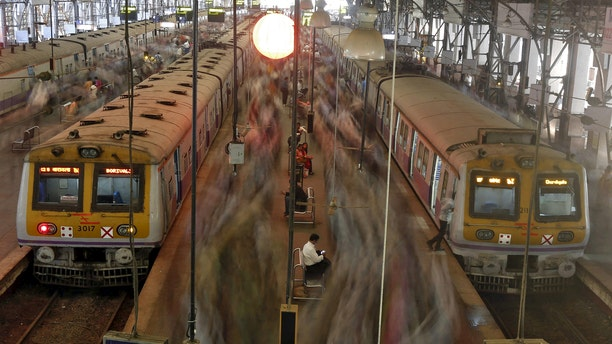File photo: Commuters disembark from crowded suburban trains during the morning rush hour at Churchgate railway station in Mumbai, India, February 25, 2016. (REUTERS/Shailesh Andrade)