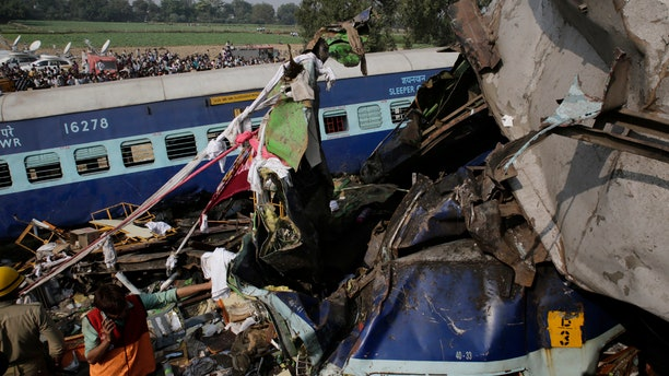 Rescuers work on the site of a train derailment accident in Kanpur Dehat, India, Sunday, Nov. 20, 2016.