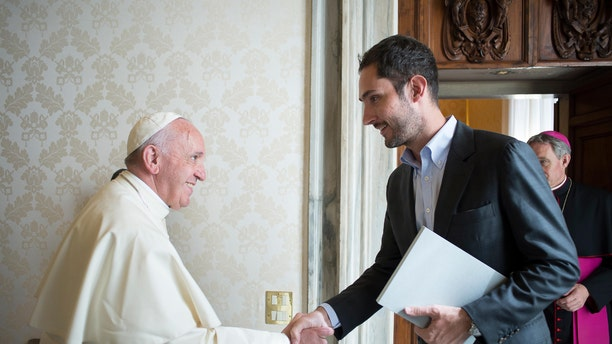 Pope Francis shakes hands with Kevin Systrom, CEO and co-founder of Instagram, during a private audience at the Vatican Friday, Feb. 26, 2016. (L' Osservatore Romano/pool photo via AP)