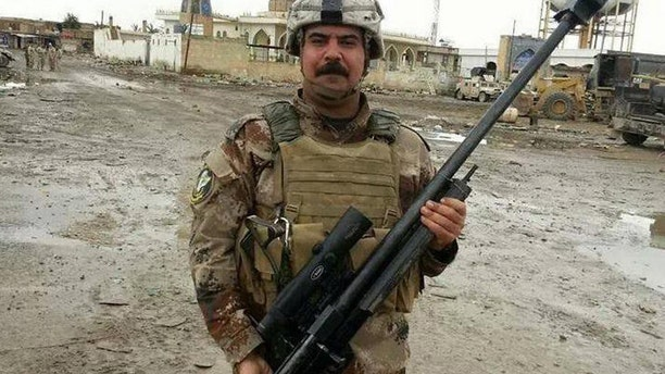 Photo obtained by military blog War is Boring shows Iraqi special forces soldier in Fallujah holding an Iranian-made Sayyad rifle.