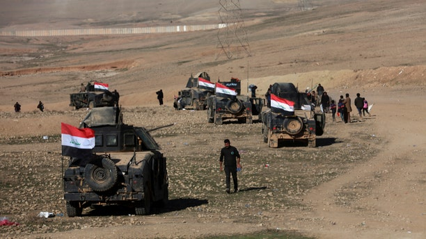 Iraqi security forces advance during fighting against Islamic State militants in the western side of Mosul, Iraq, Saturday, Feb. 25. 2017. (AP Photo/ Khalid Mohammed)