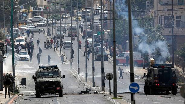 May 14, 2018: Palestinians clash with Israeli troops following a protest against the opening of the U.S. embassy in Jerusalem, in the West Bank city of Bethlehem.