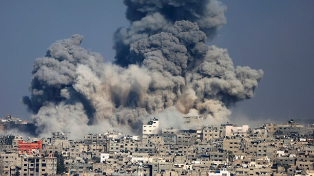 July 29, 2014: Smoke from the explosion of an Israeli strike rise over Gaza City. Israel escalated its military campaign against Hamas on Tuesday, striking symbols of the group's control in Gaza and firing tank shells that shut down the strip's only power plant in the heaviest bombardment in the fighting so far.