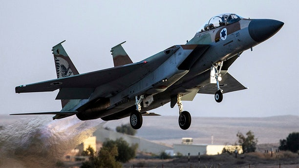 Dec. 15, 2013: An Israeli Air Force F-15I fighter jet takes off during an air force pilots' graduation ceremony at Hatzerim air base in southern Israel .