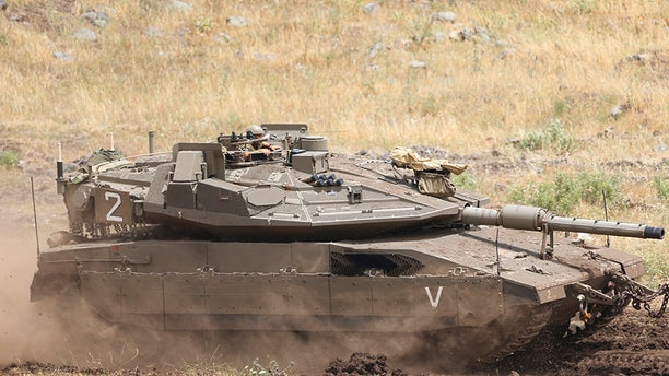 May 10, 2018: An Israeli Tank drives in the Israeli-controlled Golan Heights, near the border with Syria.