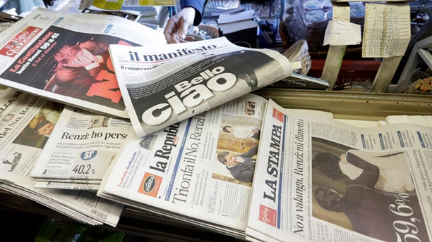 Newspaper headlines show Italian Premier Matteo Renzi's resignation following the result of Sunday's constitutional referendum, at a newsstand in Rome, Monday, Dec. 5, 2016. Italian voters dealt Premier Renzi a resounding rebuke early Monday by rejecting his proposed constitutional reforms, plunging Europe's fourth-largest economy into political and economic uncertainty. (AP Photo/Gregorio Borgia)